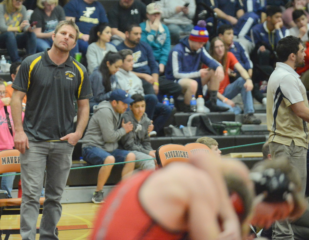 . Thompson Valley coach Steve Gerrard looks on as Trent Suppus wrestles Loveland\'s Cody Donovan for third place at 145 pounds at Saturday\'s 4A Region 4 wrestling tournament at Mead. (Mike Brohard/Loveland Reporter-Herald)