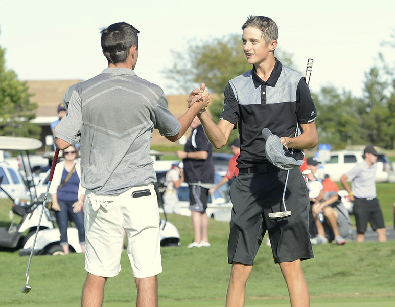 Mountain View's Wes Weber, right, shakes hands with Roosevelt's Tyler Severin after winning the individual title on the fourth playoff hole during the 4A Region 3 tournament at Boomerang Golf Course in Greeley on Tuesday.