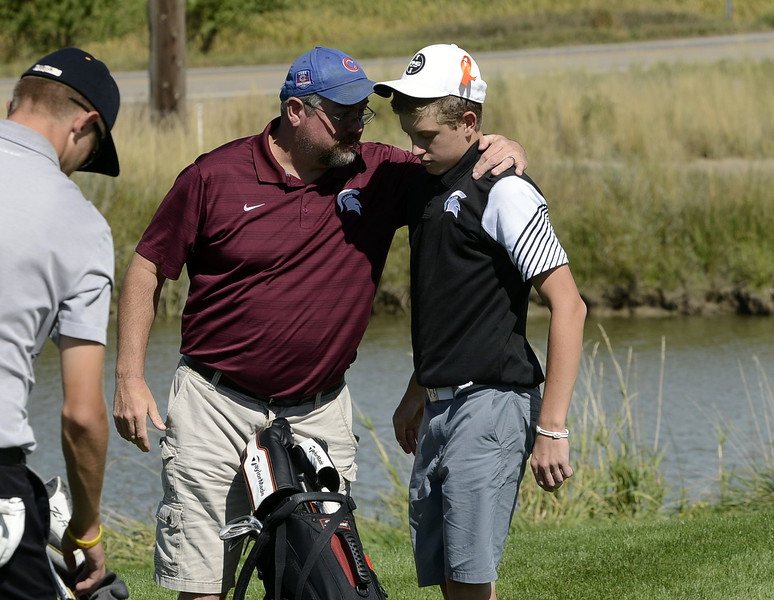 Berthoud coach Mike Burkett, left, talks with Cameron Poll after his round during the Region 3 tournament at Boomerang Golf Course in Greeley on Tuesday.
