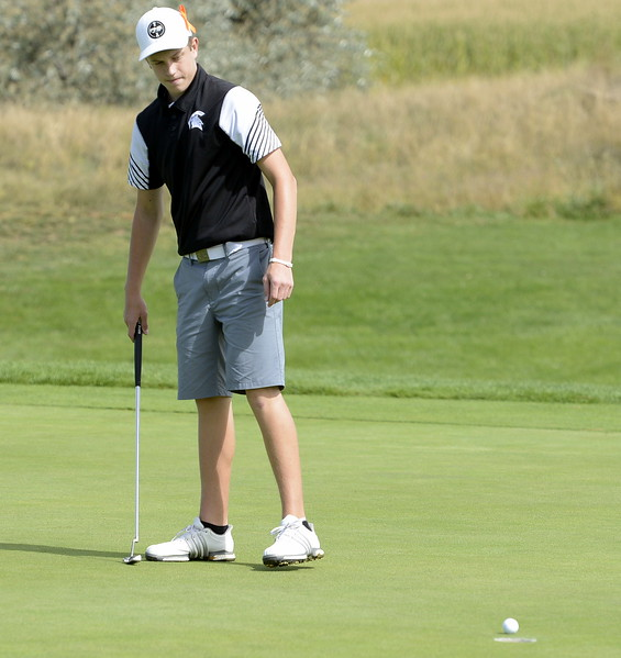 Berthoud's Cameron Poll watches his putt on the eighth hole during the 4A Region 3 tournament on Tuesday at Boomerang Golf Course in Greeley.