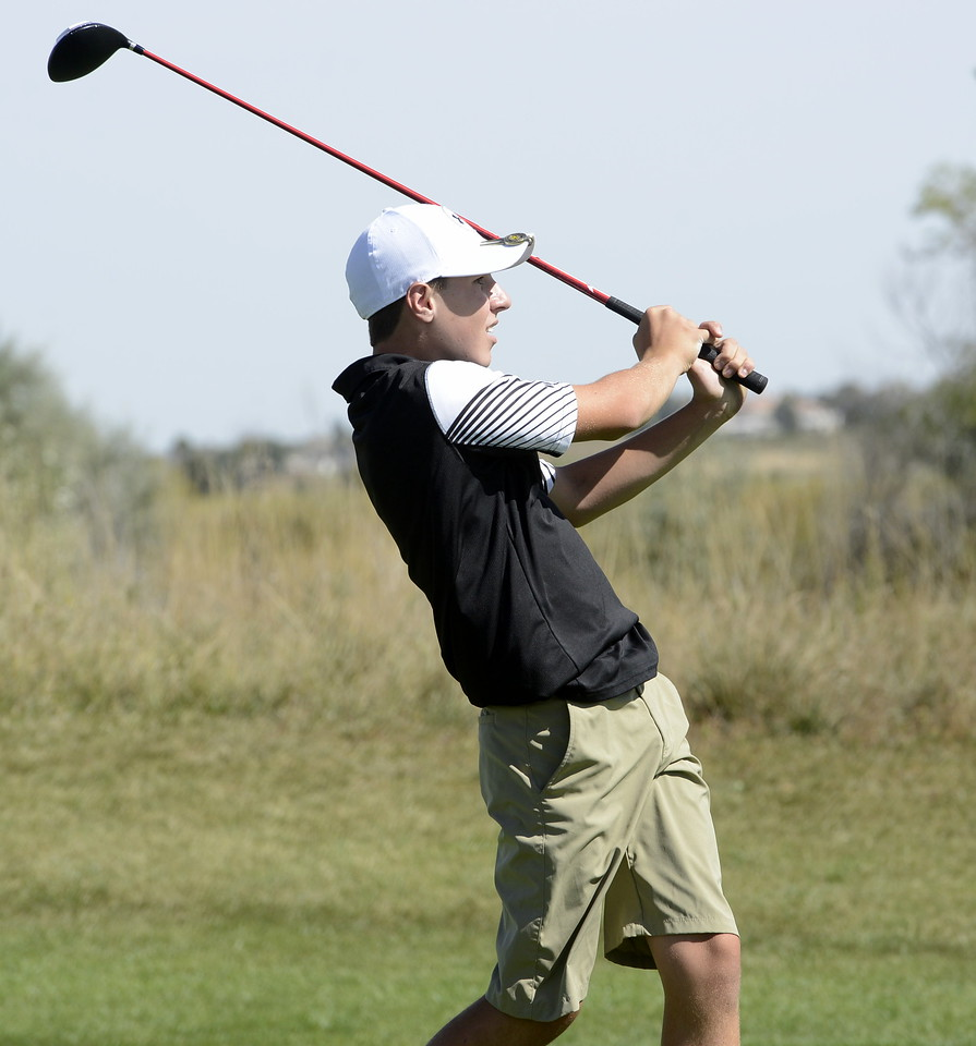 Berthoud's Matt Haberkon watches his 17th tee shot during the Region 3 tournament at Boomerang Golf Course in Greeley on Tuesday.
