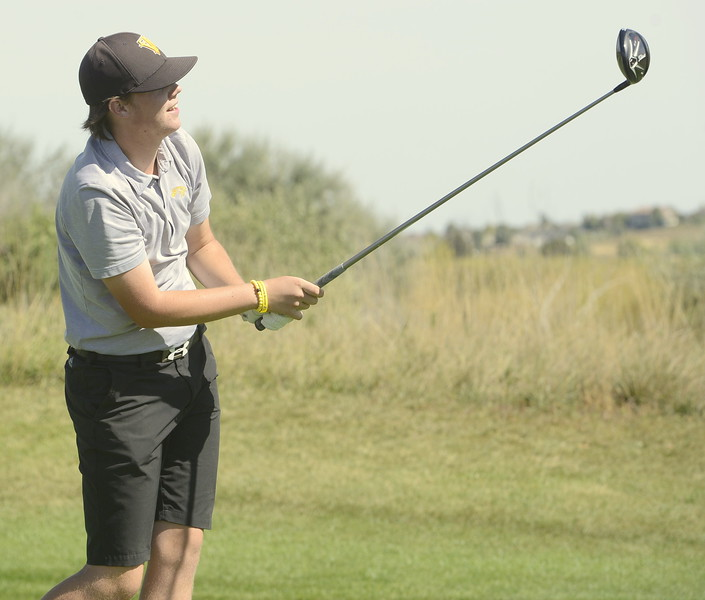 Thompson Valley's Chase Corlett watches his 17th tee shot during the Region 3 tournament at Boomerang Golf Course in Greeley on Tuesday.