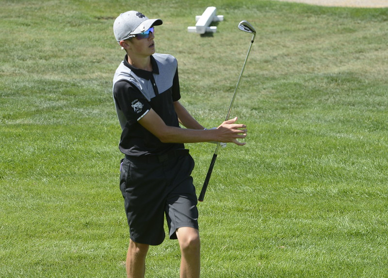 Mountain View's Wes Weber watches his approach shot in the 18th hole during the Region 3 tournament at Boomerang Golf Course in Greeley on Tuesday.