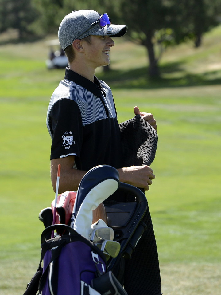 Wes Weber is all smiles after finishing his round during the Region 3 tournament at Boomerang Golf Course in Greeley on Tuesday.