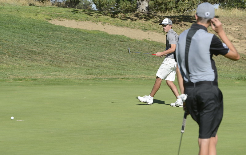 Roosevelt's Tyler Severin nearly misses a putt as Mountain View's Wes Weber looks on during the 4A Region 3 tournament on Tuesday at Boomerang Golf Course in Greeley.