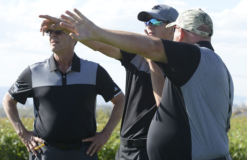 Mountain View's Wes Weber talks strategy with coach Dave Hunn and coach John Perry during the 4A Region 3 tournament at Boomerang Golf Course in Greeley on Tuesday.