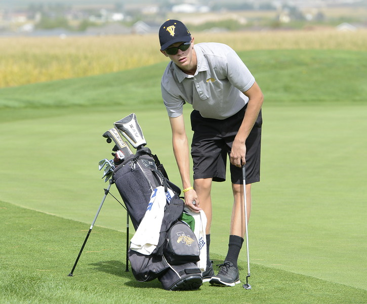 Thompson Valley's Darren Edwards reaches for his towell during the 4A Region 3 tournament on Tuesday at Boomerang Golf Course in Greeley.