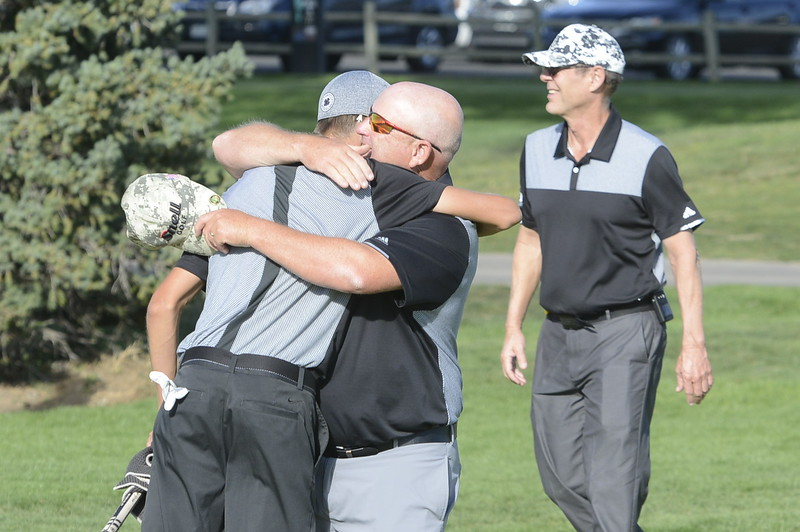 Mountain View coach Dave Hunn gives Wes Weber a hug after Weber won the 4A Region 3 tournament in a playoff on Tuesday at Boomerang Golf Course in Greeley on Tuesday.