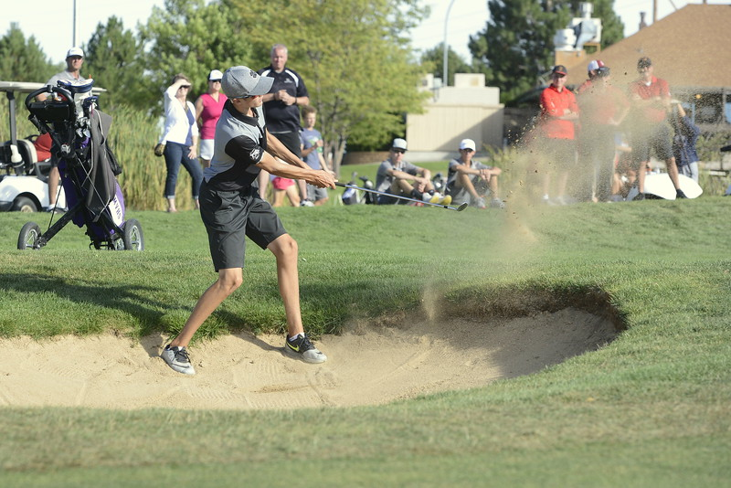 Mountain View's Wes Weber blasts a sand shot out of a bunker on the fourth playoff hole during the 4A Region 3 tournament at Boomerang Golf Course in Greeley on Tuesday.