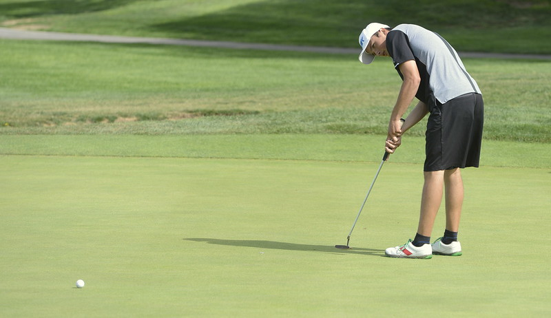 Mountain View's Drew Mettler watches his putt on the ninth green during the 4A Region 3 tournament on Tuesday at Boomerang Golf Course in Greeley.