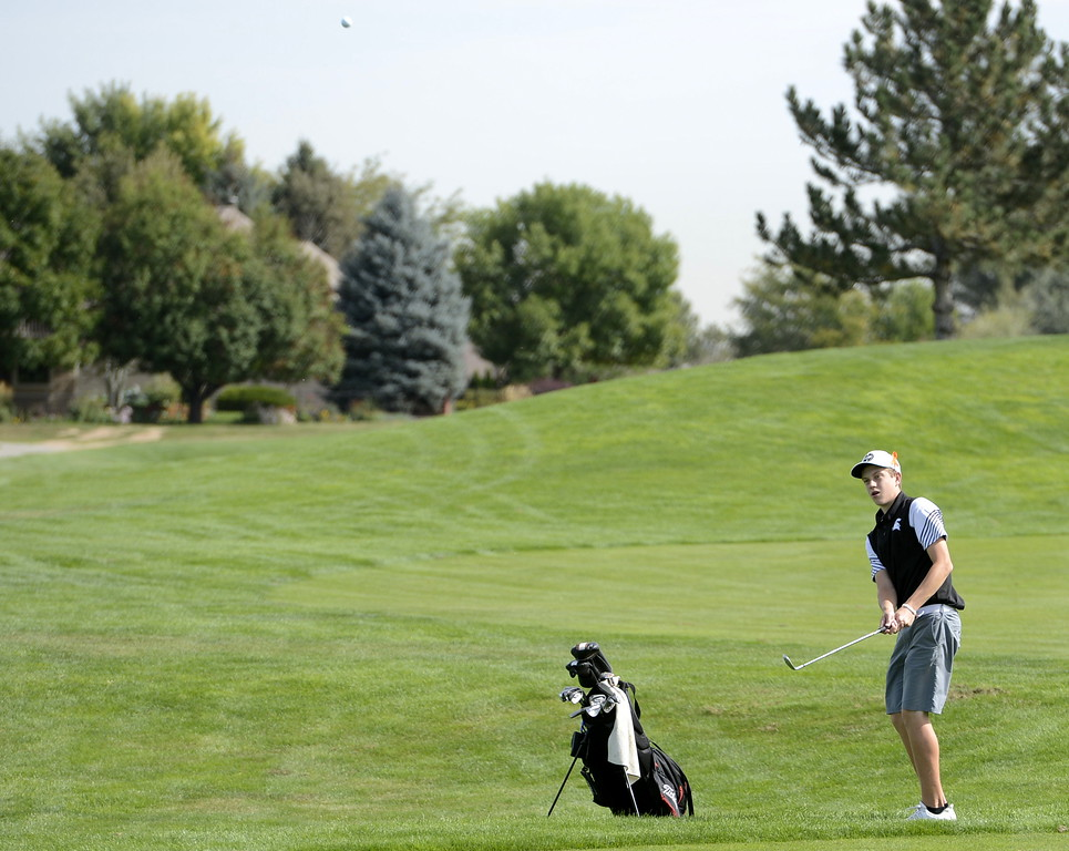 Berthoud's Cameron Poll watches his approach shot during the 4A Region 3 tournament on Tuesday at Boomerang Golf Course in Greeley.
