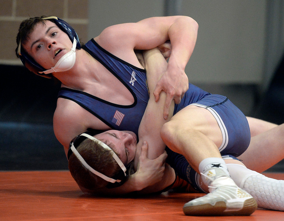 . MEAD, CO: February 16, 2019:   Cole Hoffman, top, of Frederick, takes Keegan Caldwell, of Mead, at 132-pounds during the 4A Regionals at Mead High School on February 16, 2019. For more photos go to Bocopreps.com. (Photo by Cliff Grassmick/Staff Photographer)