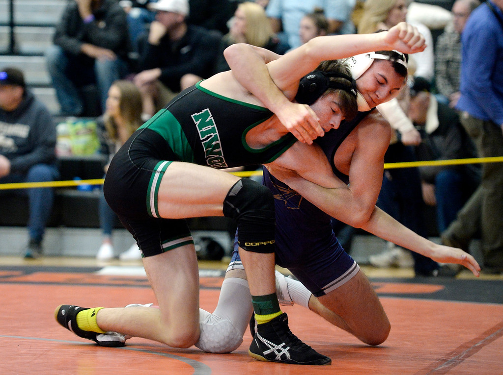 . MEAD, CO: February 16, 2019:  Jonah Sanders, top, of Frederick, takes on Aiden Coopman, of Niwot, at 138-pounds,  during the 4A Regionals at Mead High School on February 16, 2019. For more photos go to Bocopreps.com. (Photo by Cliff Grassmick/Staff Photographer)