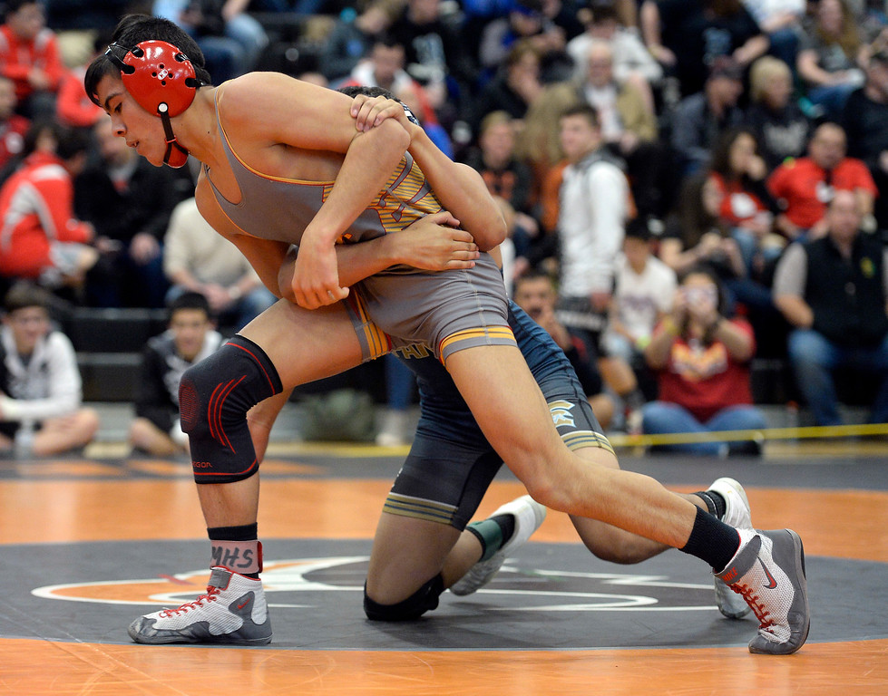 . MEAD, CO: February 16, 2019: Drew Sandoval, left, of Skyline, takes on Max Flores, of Greeley West, at 132-pounds during the 4A Regionals at Mead High School on February 16, 2019. For more photos go to Bocopreps.com. (Photo by Cliff Grassmick/Staff Photographer)