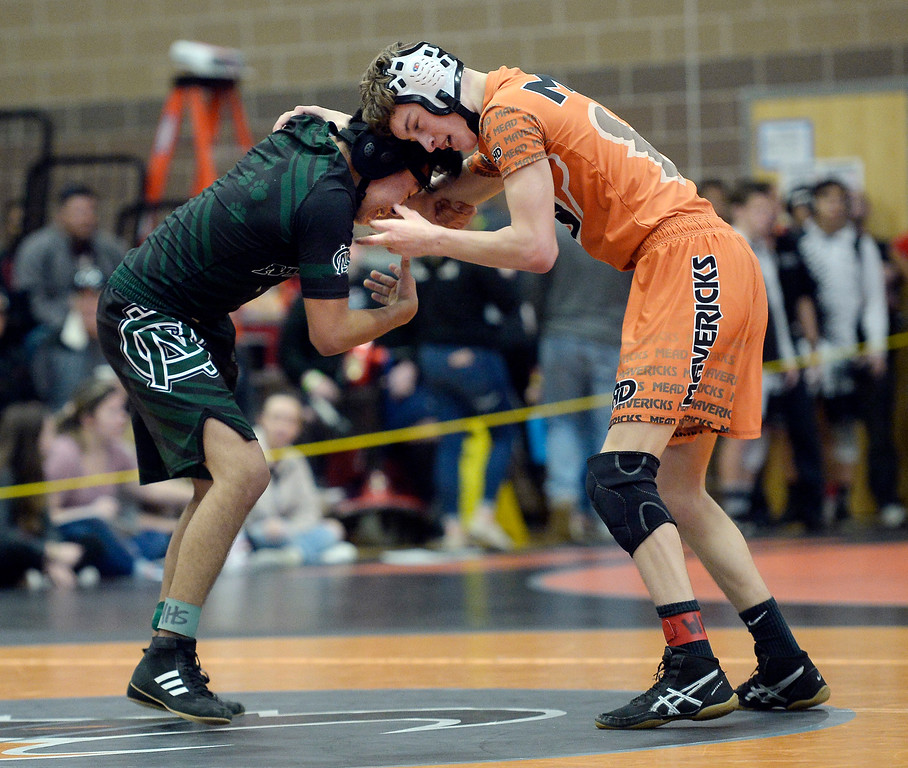 . MEAD, CO: February 16, 2019: Quin Dukes, of Mead,  right, takes on Johnny Ramirez, of Niwot, at 120-pounds, during the 4A Regionals at Mead High School on February 16, 2019. For more photos go to Bocopreps.com. (Photo by Cliff Grassmick/Staff Photographer)