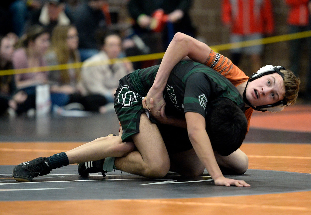 . MEAD, CO: February 16, 2019: Quin Dukes, of Mead, top, takes on Johnny Ramirez, of Niwot, at 120-pounds, during the 4A Regionals at Mead High School on February 16, 2019. For more photos go to Bocopreps.com. (Photo by Cliff Grassmick/Staff Photographer)