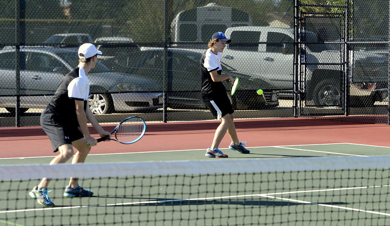 Thompson Valley's Bailey Hamrick (left) looks on as brother Brandon, his No. 2 doubles partner, returns a shot during their regional finals match with Phil Geraghty and Sam Troughton of Dawson, who won a 6-4, 6-3 decison Friday in Greeley.