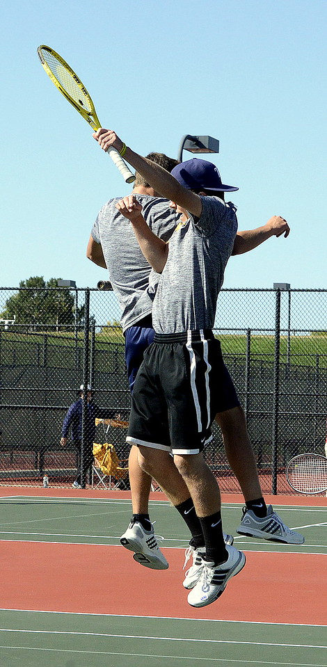 Thompson Valley No. 4 doubles partners Seth Dotson (front) and Aaron Hardy chest bump after winning the regional title Friday in Greeley in straight sets.