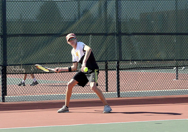 Tony Klagge of Thompson Valley hits a forehand during his No. 1 singles regional third-place match with Windsor's Max McManigal on Friday in Greeley. Klagge won the match, 1-6, 6-1, 6-3.