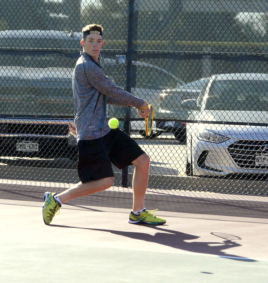 Thompson Valley's Adam Brubaker eyes a backhand return during his No. 3 singles third-place match with Jared Nielson of Silver Creek on Friday in Greeley. Brubaker won 6-3, 6-2.