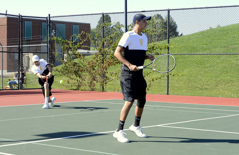 Thompson Valley's Haakon Irey returns a shot as his No. 1 doubles partner Jonathan Szwaja eyes the Windsor movements on the other side of the net during the regional third-place match Friday in Greeley. The Eagles' duo won 3-6, 6-3, 6-2.