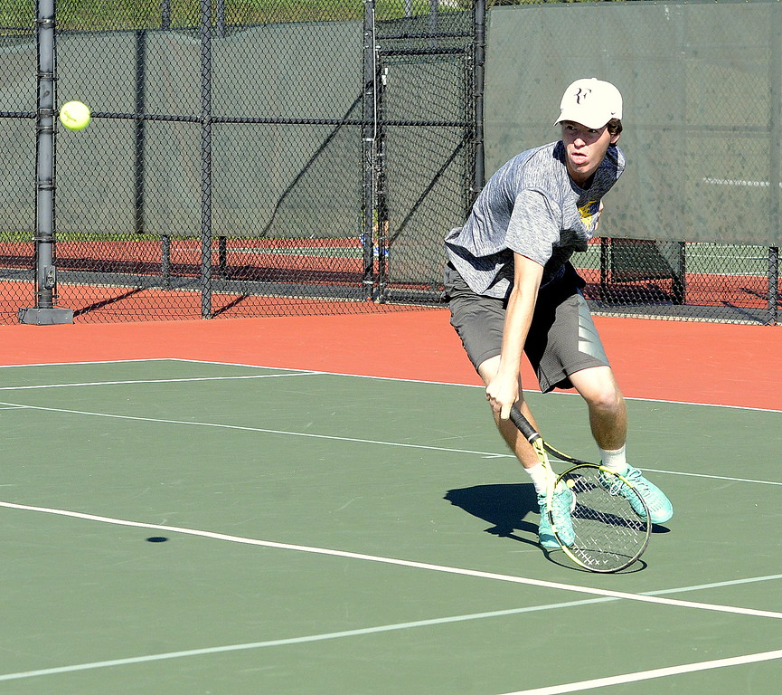 Thompson Valley No. 2 singles player Landon Lees comes in to return a shot during his regional third-place match in Greeley with Joe Lombardelli of Northridge. Less won, 6-1, 6-1.
