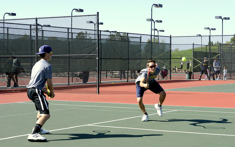 Thompson Valley's Aaron Hardy returns a shot as No. 4 doubles partner Seth Dotson moves in to back up during their regional final Friday in Greeley. The pairing beat Windsor 6-1, 6-3 for the title.