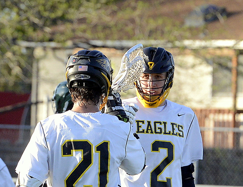 Thompson Valley's Riley Kinney (2) and Micah Payton celebrate Kinney's goal off a Payton assist Tuesday's 4A boys lacrosse state playoff game at Patterson Stadium. (Mike Brohard/Loveland Reporter-Herald)