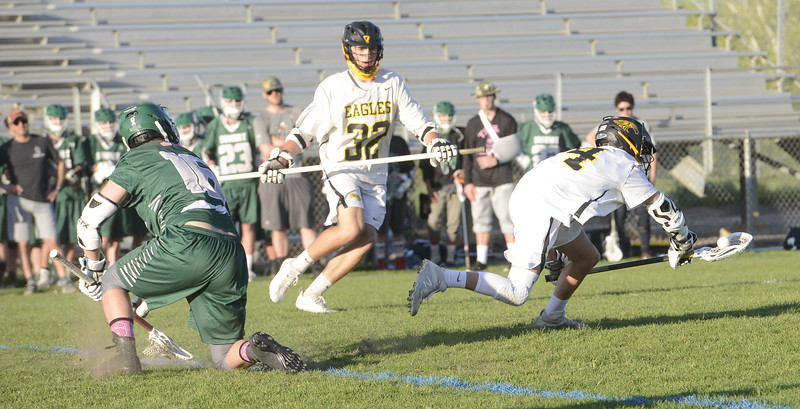Thompson Valley's Jaydon Adfield gets tripped up by Summit's Aidan Casias coming out of a faceoff during Tuesday's 4A boys lacrosse state playoff game at Patterson Stadium. (Mike Brohard/Loveland Reporter-Herald)