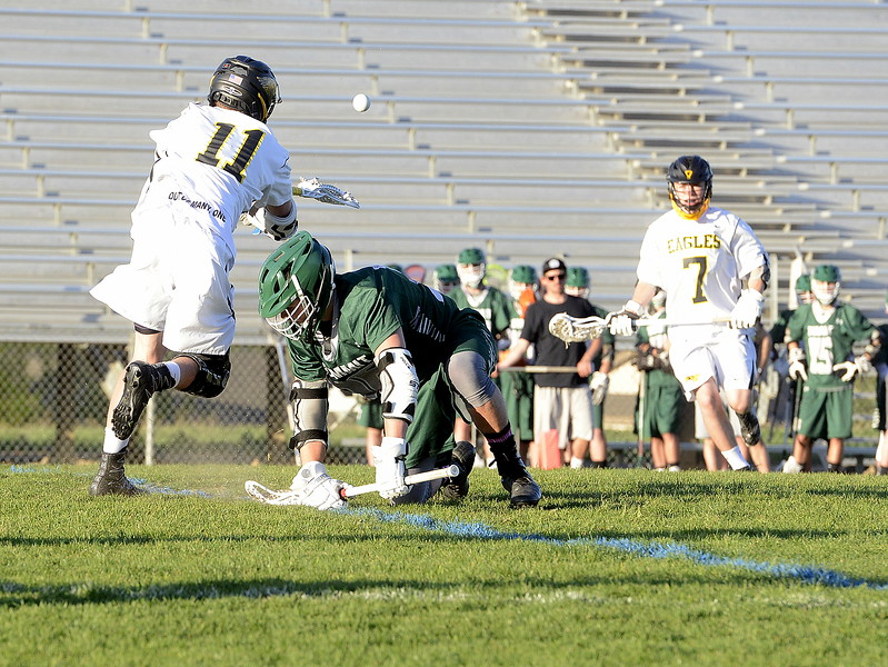 Thompson Valley's Jaydon Arnold shovels a pass to teammate Payton Ramsden after winning a faceoff during Tuesday's 4A boys lacrosse state playoff game at Patterson Stadium. (Mike Brohard/Loveland Reporter-Herald)