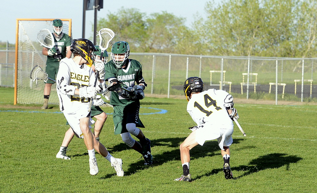 . Thompson Valley\'s Jared McFerran comes off a pick from Greg Bilek during Tuesday\'s 4A boys lacrosse state playoff game at Patterson Stadium. (Mike Brohard/Loveland Reporter-Herald)
