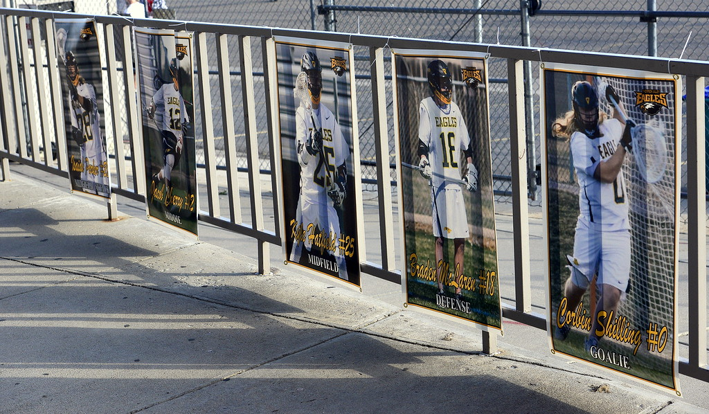 . Posters of Thompson Valley\'s seniors line the fence at Patterson Stadium as the Eagles hosted a first-round 4A boys lacrosse state playoff game at Patterson Stadium on Tuesday. (Mike Brohard/Loveland Reporter-Herald)