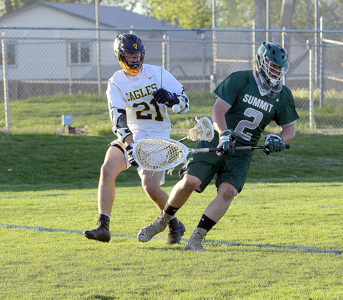 Micah Payton of Thompson Valley made Summit goalie Sawyer March regret straying too far from the net, creating a turnover resulting in a goal Tuesday's 4A boys lacrosse state playoff game at Patterson Stadium. (Mike Brohard/Loveland Reporter-Herald)