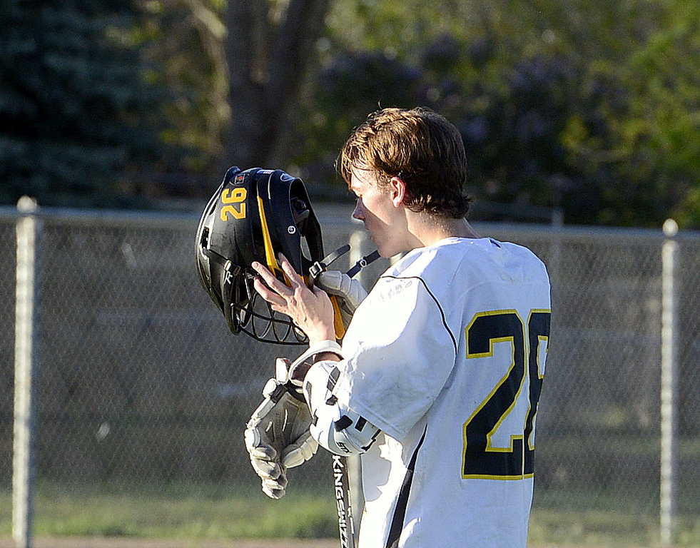 . Thompson Valley\'s Greg Bilek puts on his helmet as a new quarter is set to begin during Tuesday\'s 4A boys lacrosse state playoff game at Patterson Stadium. (Mike Brohard/Loveland Reporter-Herald)
