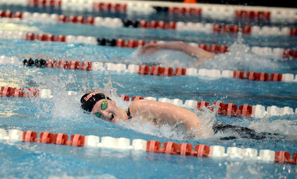 . Erin Lang of Loveland spent the first half of the 500-yard freestyle playing catchup, but eventually won going away during Friday\'s 4A State Swimming & Diving Finals at Veterans Memorial Aquatic Center in Thornton. (Mike Brohard/Loveland Reporter-Herald)
