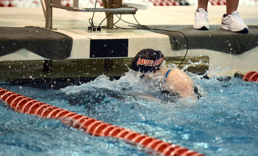 . Jordan Reichhardt of Loveland makes the turn in the 100-yard butterfly during Friday\'s 4A State Swimming & Diving Finals at Veterans Memorial Aquatic Center in Thornton. She placed 14th. (Mike Brohard/Loveland Reporter-Herald)