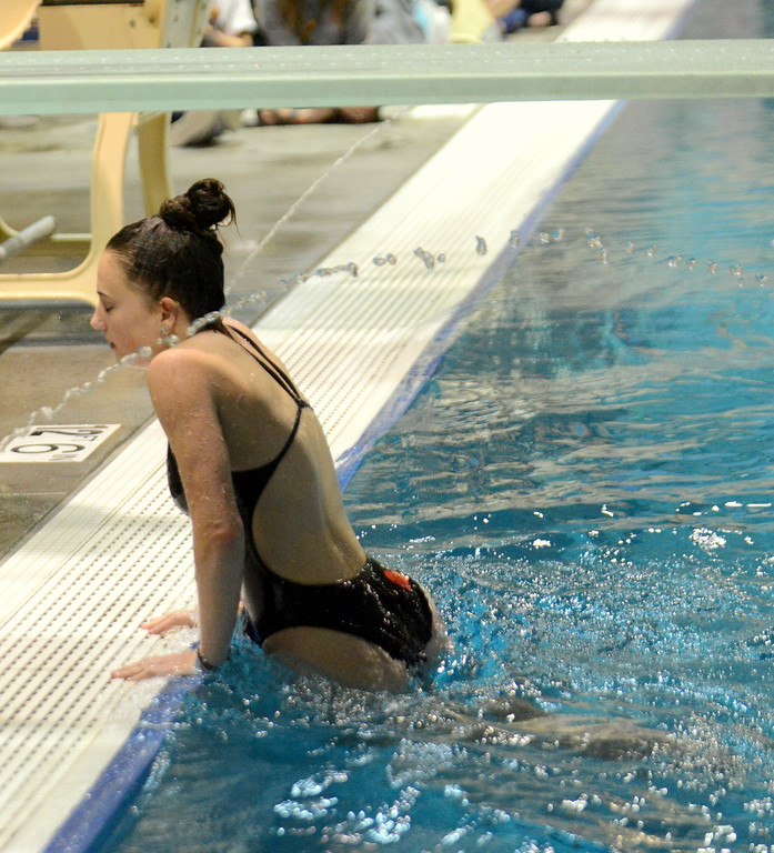 . Loveland diver Olivia Brock climbs out of the pool after her second dive during Friday\'s 4A State Swimming & Diving Finals at Veterans Memorial Aquatic Center in Thornton. (Mike Brohard/Loveland Reporter-Herald)