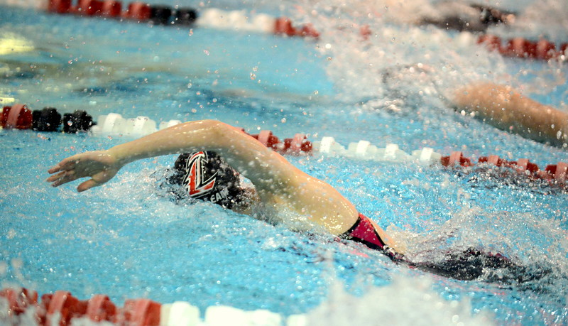 Loveland's Adley Morrison competes in the 50-yard freestyle consolation finals during Friday's 4A State Swimming & Diving Finals at Veterans Memorial Aquatic Center in Thornton. She placed 17th. (Mike Brohard/Loveland Reporter-Herald)