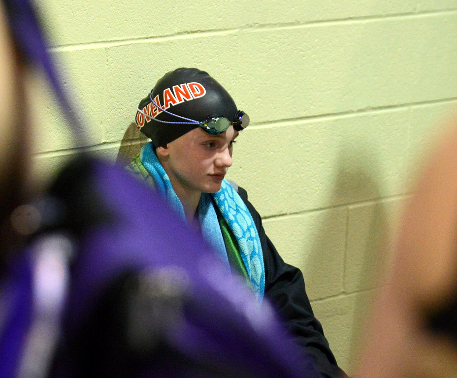 . Loveland\'s Jordan Reichhardt sits against the wall as she waits for the consolation finals of the 100-yard butterfly during Friday\'s 4A State Swimming & Diving Finals at Veterans Memorial Aquatic Center in Thornton. (Mike Brohard/Loveland Reporter-Herald)