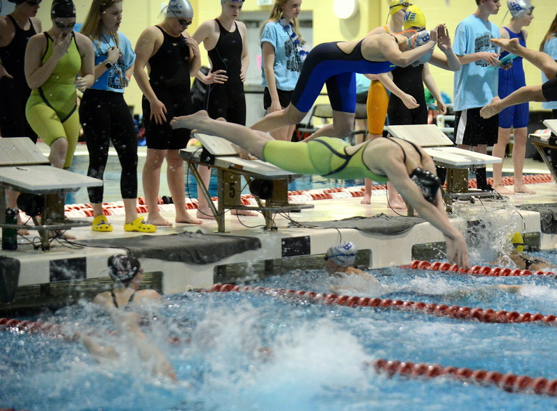 Loveland's Shannon Tyler comes off the blocks over teammate Adley Morrison as the Indians won the consolation heat of the 200-yard freestyle relay during Friday's 4A State Swimming & Diving Finals at Veterans Memorial Aquatic Center in Thornton. (Mike Brohard/Loveland Reporter-Herald)