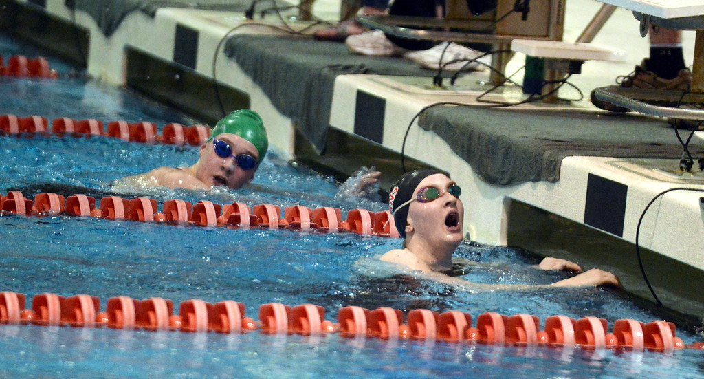 . Loveland\'s Eriin Lang gasps for air after winning the 500-yard freestyle for the third consecutive year at Friday\'s 4A State Swimming & Diving Finals at Veterans Memorial Aquatic Center in Thornton. Lang did it in a school-record time of 4:58.35.(Mike Brohard/Loveland Reporter-Herald)
