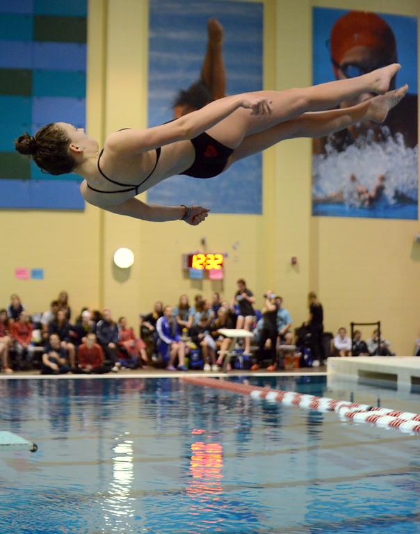 . Loveland\'s Olivia Brock twists through her second dive of finals during Friday\'s 4A State Swimming & Diving Finals at Veterans Memorial Aquatic Center in Thornton. (Mike Brohard/Loveland Reporter-Herald)