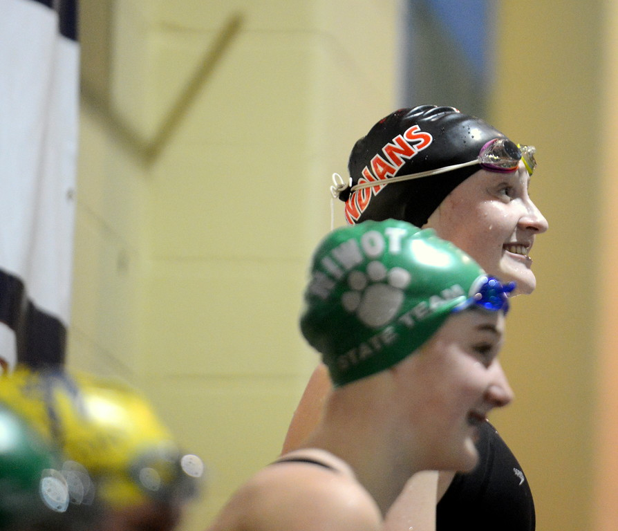 . Loveland\'s Erin Lang had her chance to smile atop the podium after winning the 500-yard freestyle for a third consecutive year during Friday\'s 4A State Swimming & Diving Finals at Veterans Memorial Aquatic Center in Thornton. (Mike Brohard/Loveland Reporter-Herald)