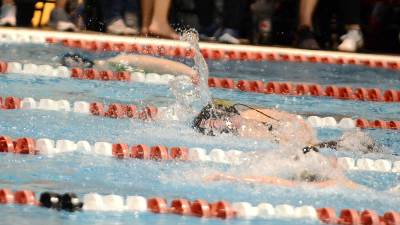 Loveland's Ashley Peet (center) and Shannon Tyler (top) compete in the 50-yard freestyle consolation finals during Friday's 4A State Swimming & Diving Finals at Veterans Memorial Aquatic Center in Thornton. Peet was 14th, Tyler 19th. (Mike Brohard/Loveland Reporter-Herald)