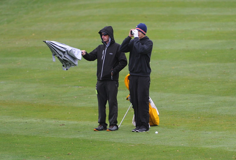 Thompson Valley coach Derek Shagin and senior Darren Edwards wait on the ninth fairway during the first round of the 4A state golf tournament on Monday at Raccoon Creek in Littleton.