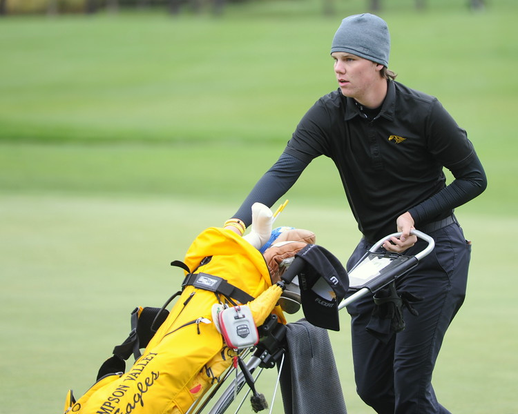 Thompson Valley's Chase Corlett heads to the next hole during the first round of the 4A state golf tournament on Monday at Raccoon Creek in Littleton.