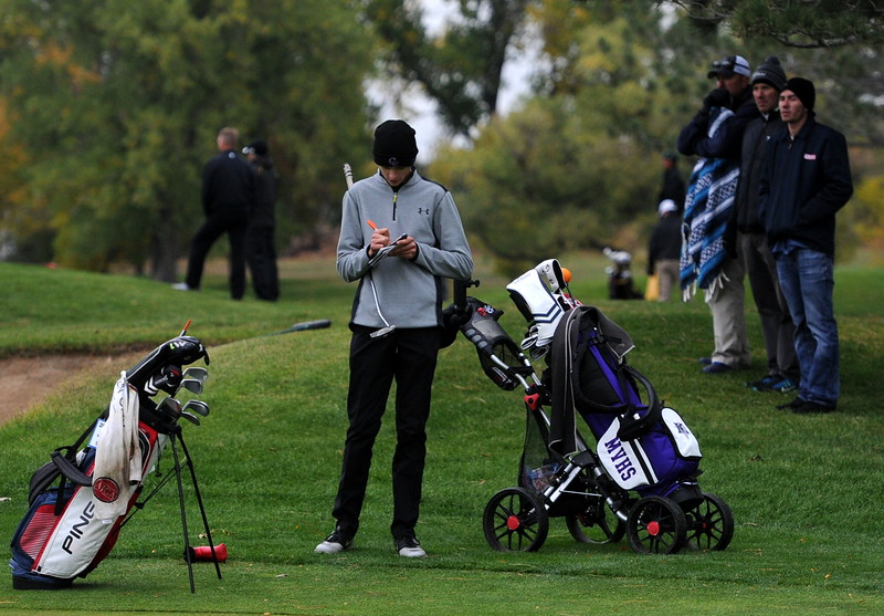Mountain View's Wes Weber fills out his scorecard after finishing his first round of the 4A state golf tournament on Monday at Raccoon Creek in Littleton.