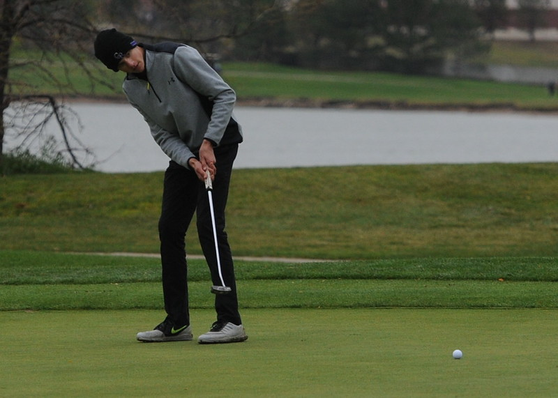 Mountain View's Wes Weber watches his putt on the 18th green during the first round of the 4A state golf tournament on Monday at Raccoon Creek in Littleton.