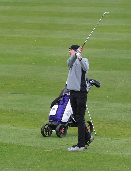 Mountain View's Wes Weber watches his approach on the ninth hole during the first round of the 4A state golf tournament on Monday at Raccoon Creek in Littleton.