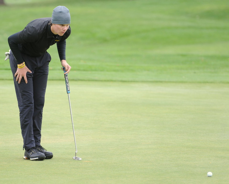 Thompson Valley's Chase Corlett lines up a putt during the first round of the 4A state golf tournament on Monday at Raccoon Creek in Littleton.